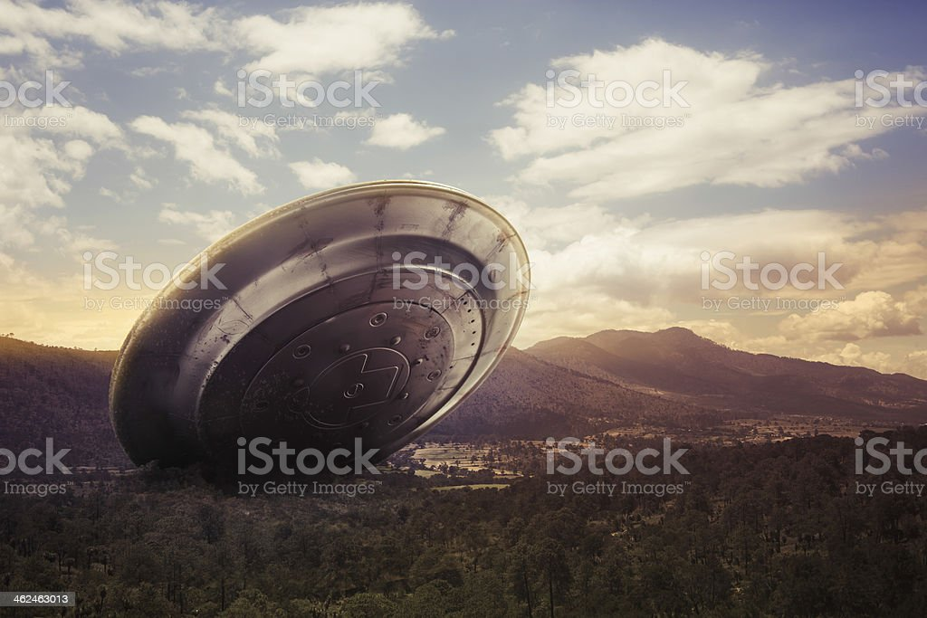UFO crashing on a valley stock photo