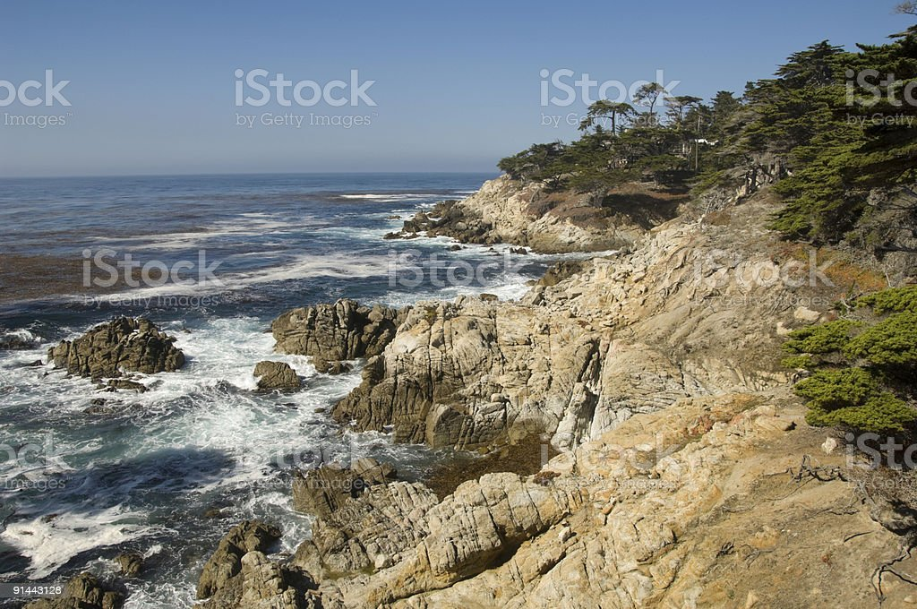 Crashing waves against rocky Carmel Coastline. stock photo