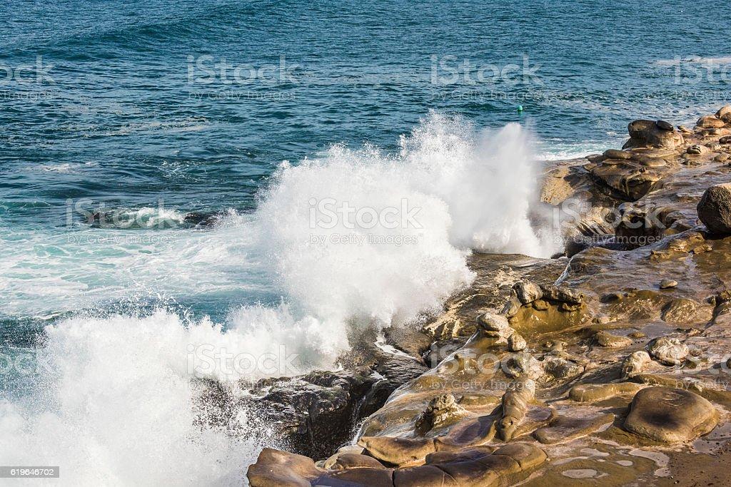 Crashing waves on La Jolla Cove in San Diego stock photo