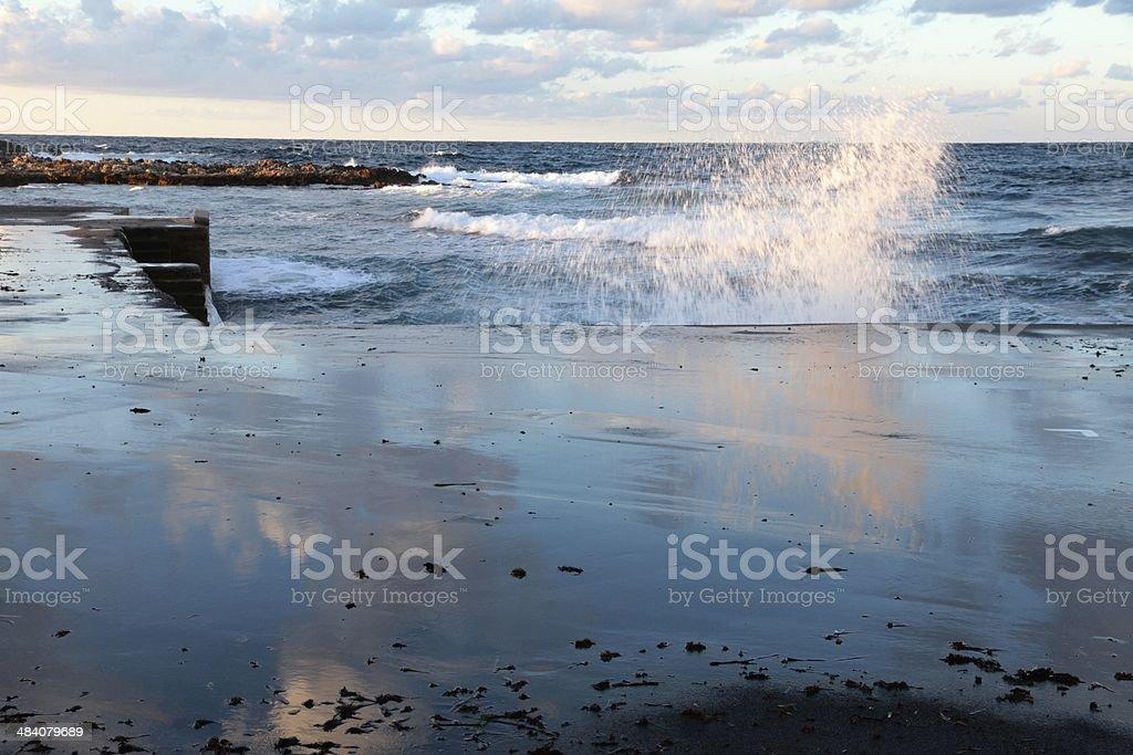 Crashing waves on the pier stock photo
