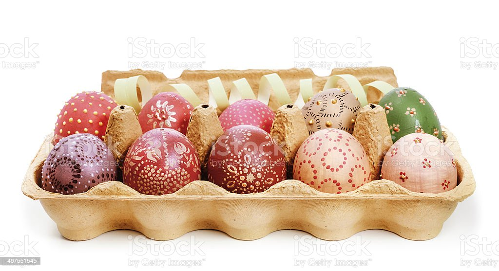 Crate with painted Easter Eggs stock photo