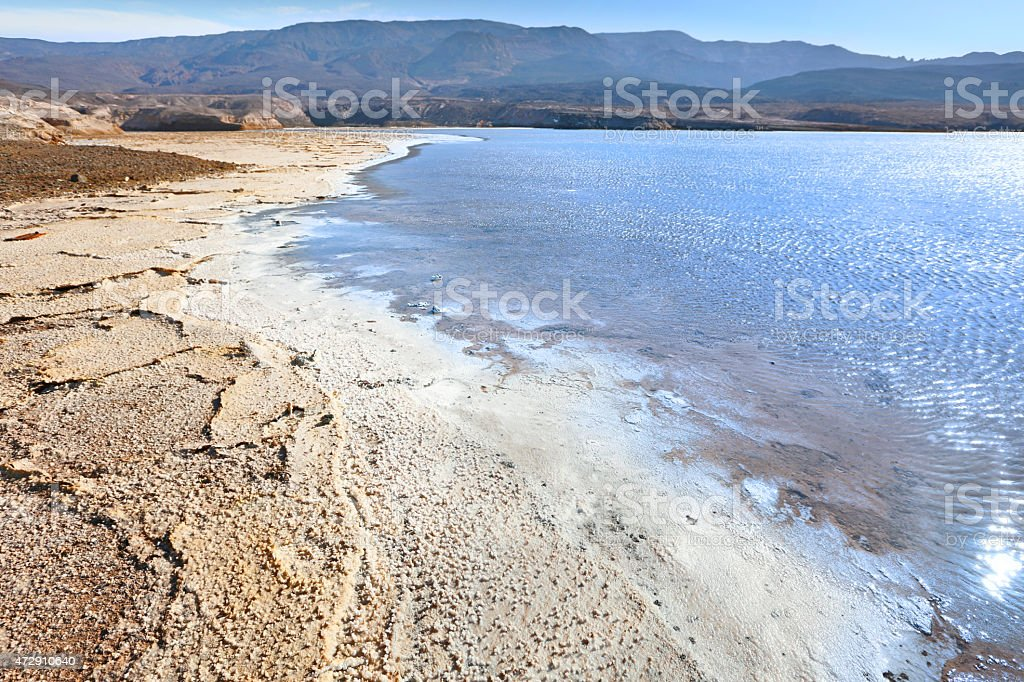 Crater dry lake Assal. Shore covered with salt. stock photo