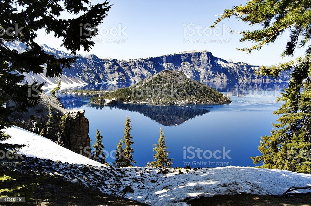 Crater Lake Oregon with snow stock photo