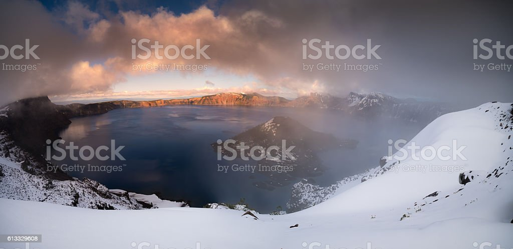 Crater lake partialy foggy stock photo