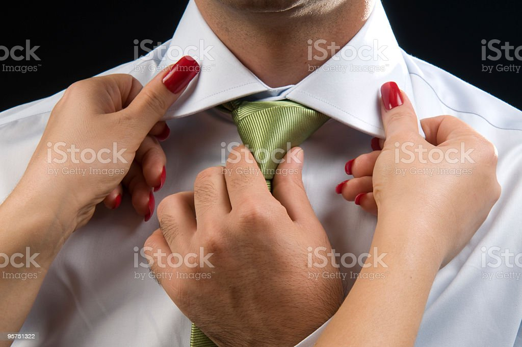 Cravat Knot And Female Hands royalty-free stock photo