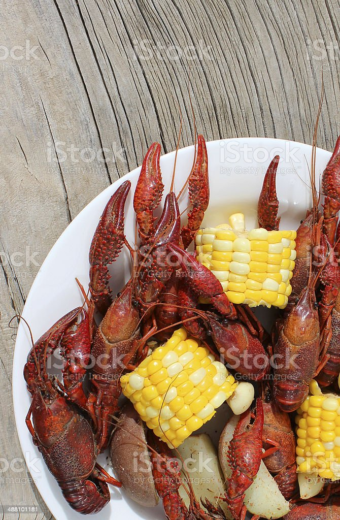 Crawfish Boil on White Plate and Rustic Wood Background stock photo