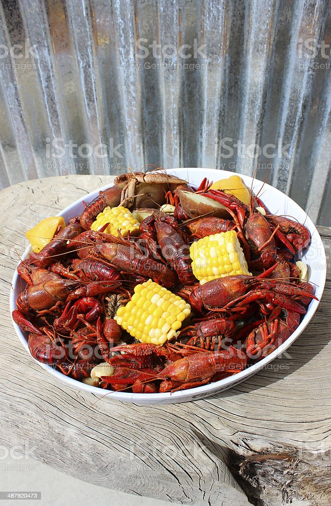 Crawfish Boil Plated on Rustic Wood Table stock photo