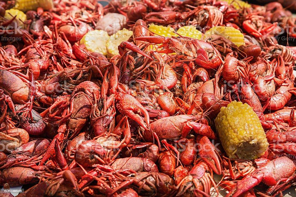 Crawfish, corn and potatoes on table at crawfish boil stock photo