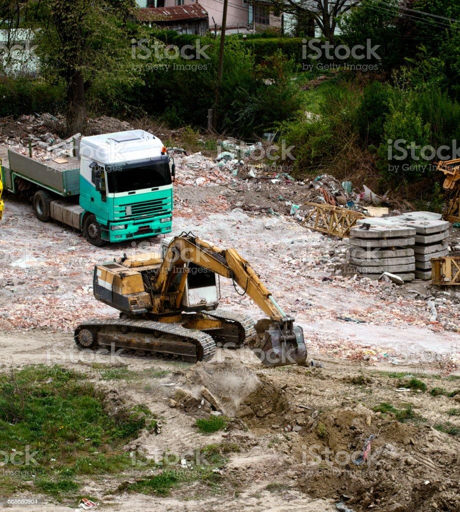 crawler excavator machine on the construction site stock photo