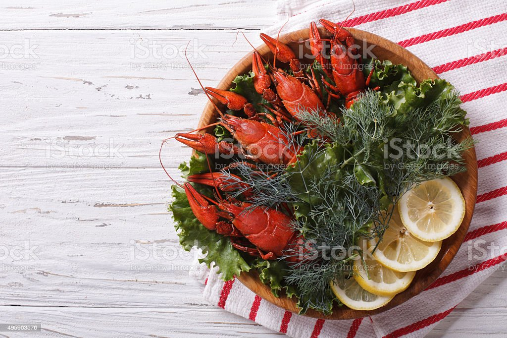 crayfish with herbs and lemon on plate. Horizontal top view stock photo