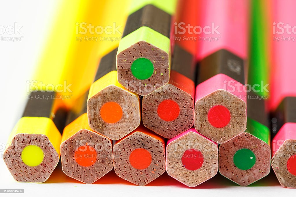 Crayons lay on the floor lined up several. stock photo
