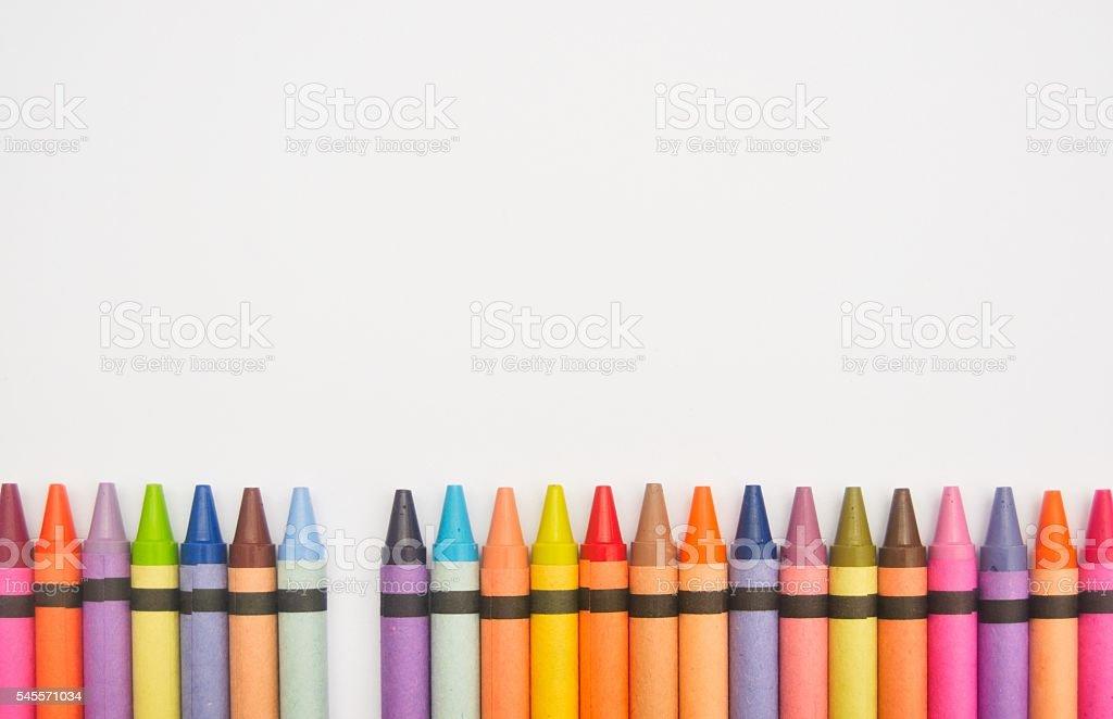 Crayons lined up in a row with one missing foto de stock libre de derechos