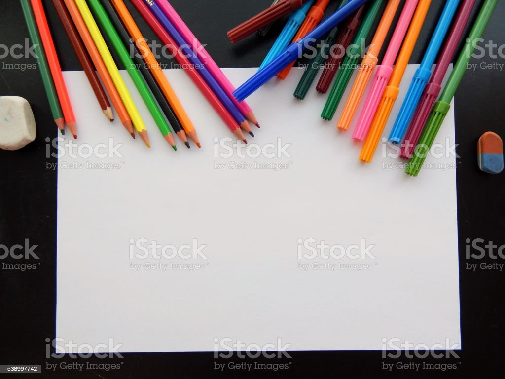 Crayons on the school board with space for text stock photo