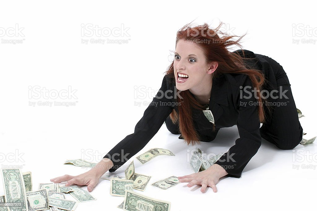 Crazed Business Woman Grabbing Money From Floor royalty-free stock photo