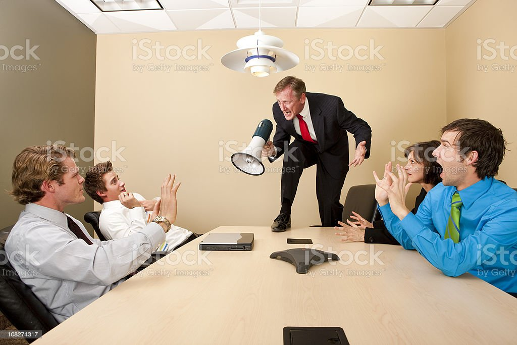 Crazy Boss Yelling at Employees stock photo