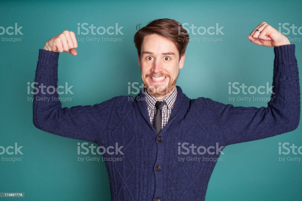 Crazy Businessman Flexing on Teal royalty-free stock photo