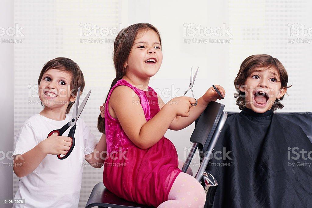 crazy childs inside hairsalon stock photo