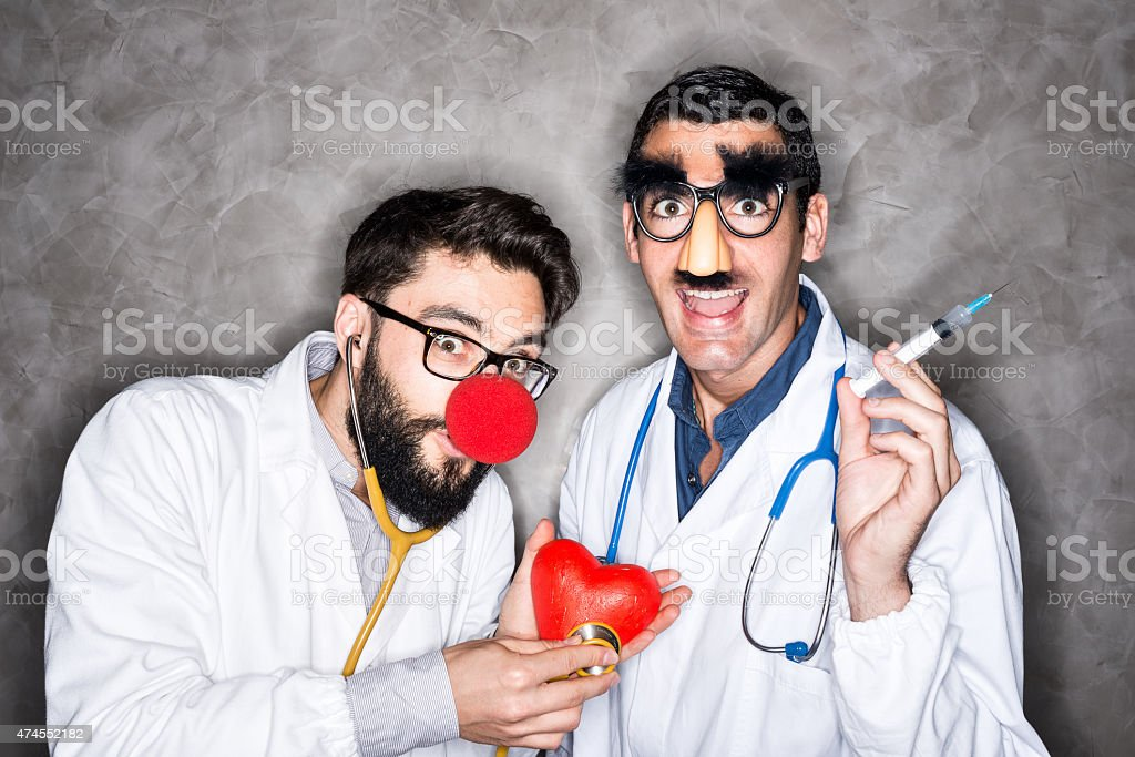 Crazy doctors with red clown nose stock photo