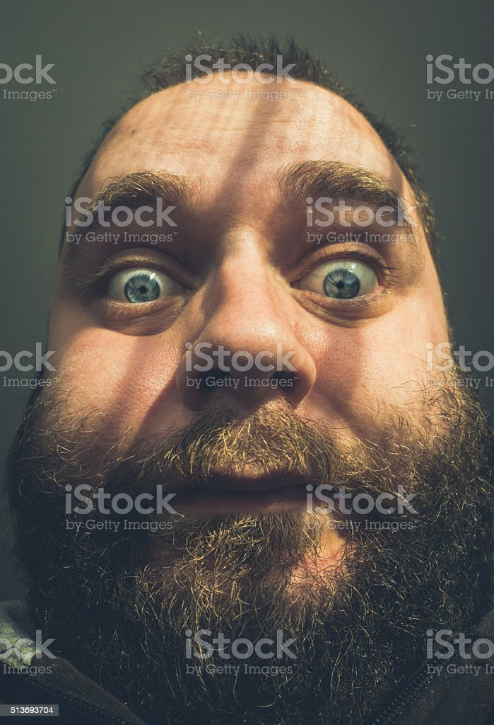 Crazy fat and bearded man close up portrait stock photo