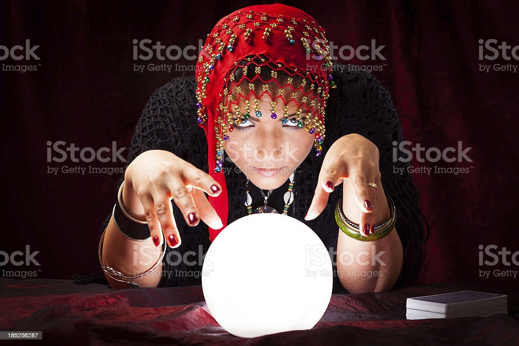 crazy fortune teller with crystal ball stock photo