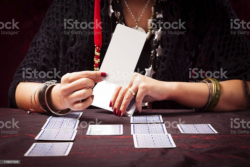 crazy fortune teller with tarot cards stock photo