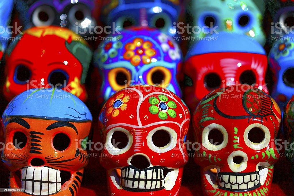 Crazy fun colorful Mexican skulls in Chichen Itza stock photo