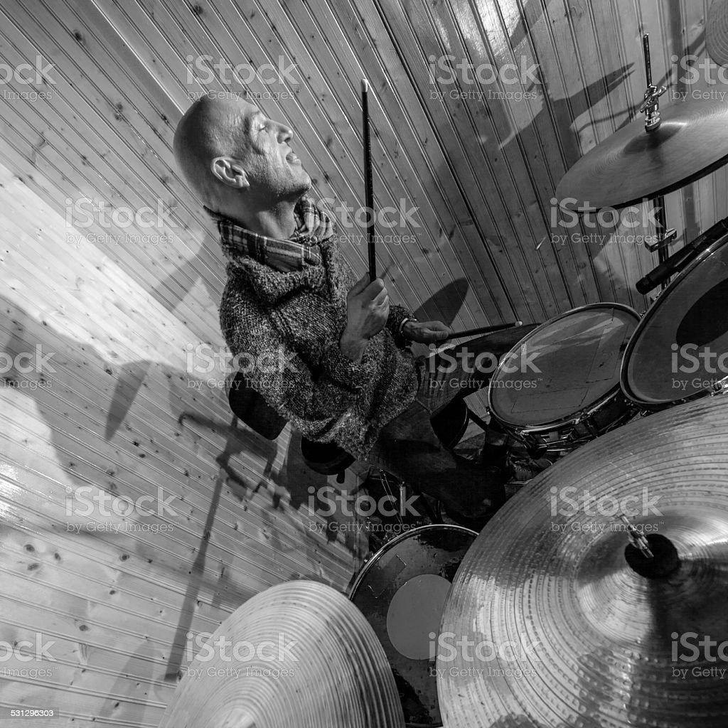 Crazy funny drummer stock photo