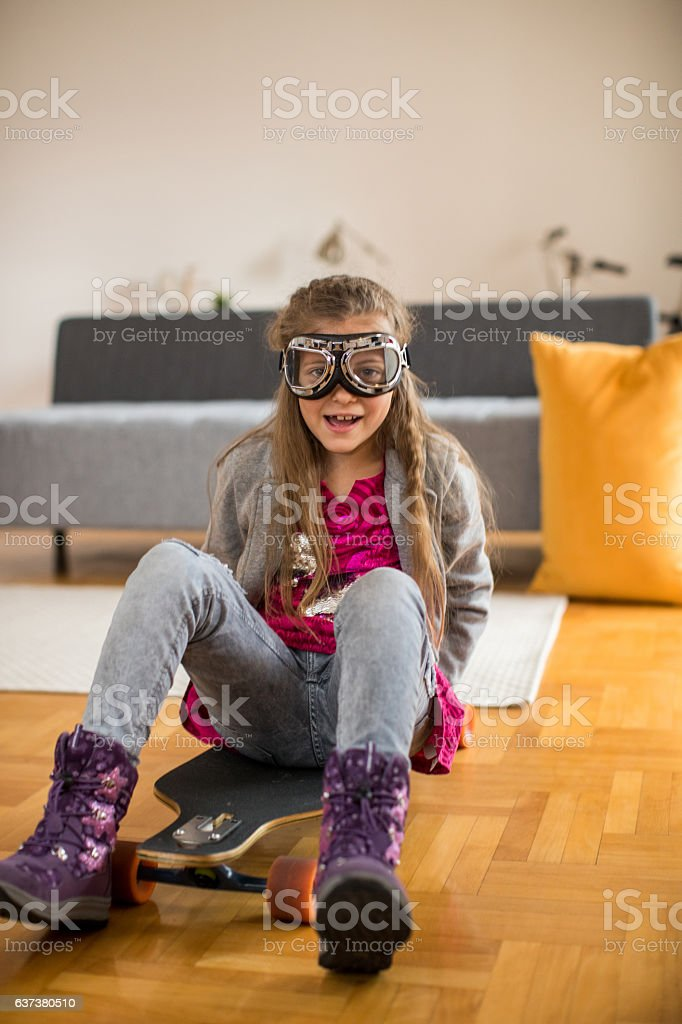 Crazy funny girl on the longboard stock photo