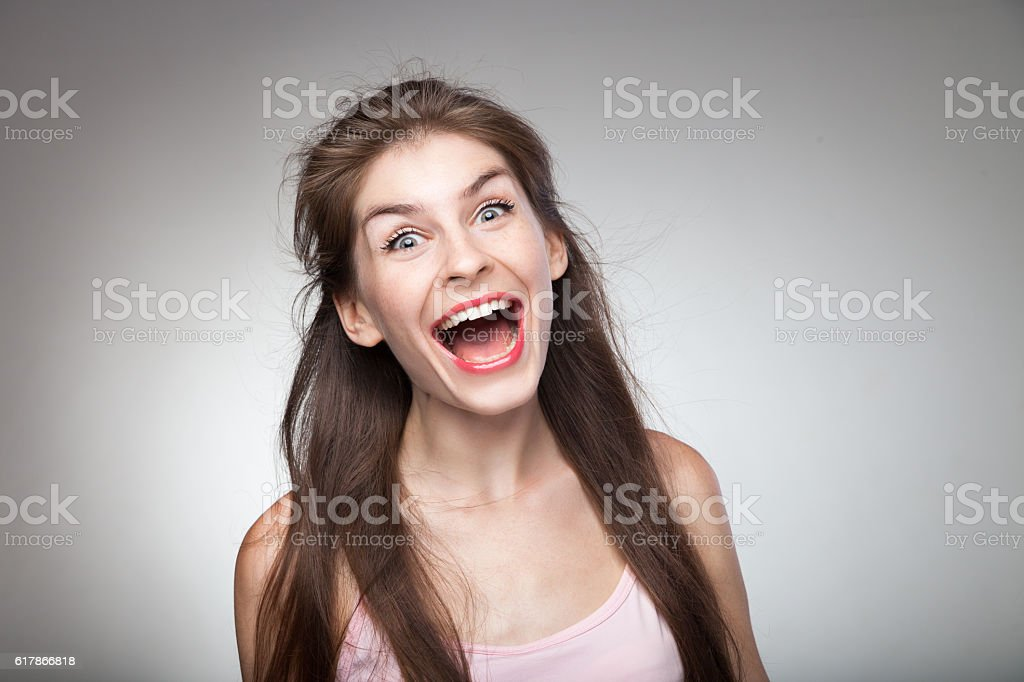 Crazy girl screaming loud. stock photo