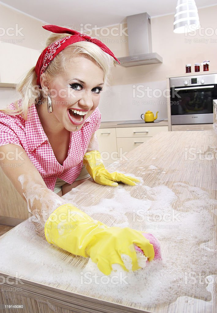 Crazy housewife cleaning kitchen royalty-free stock photo