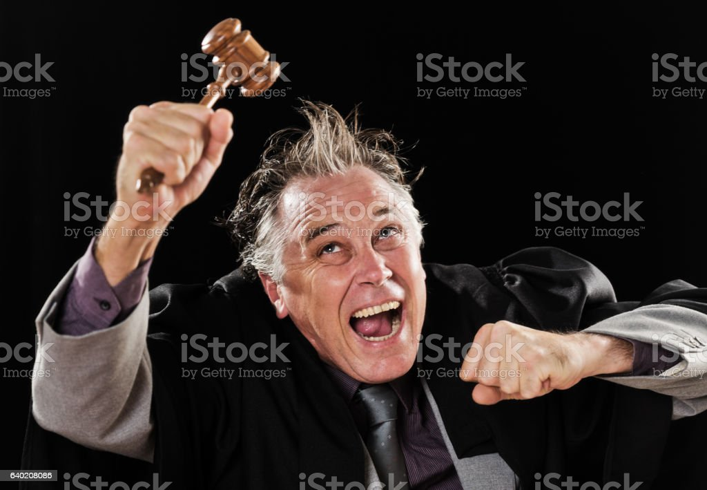 Crazy judge waves his gavel, laughing madly stock photo