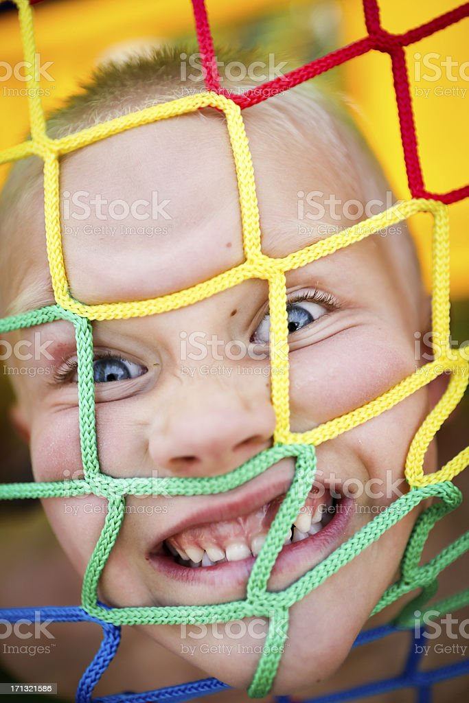 Crazy kid in bounce house stock photo