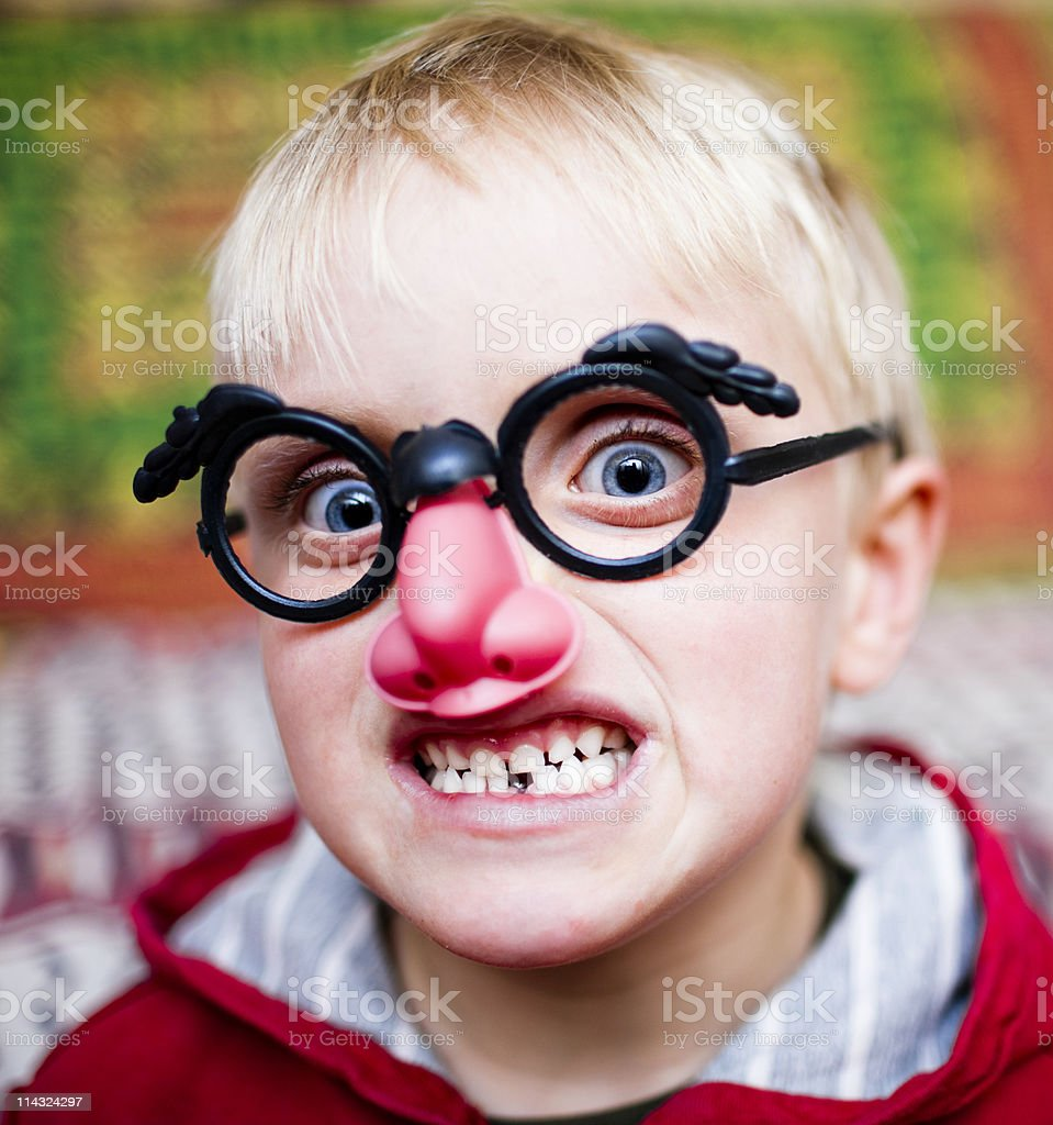 Crazy kid with joke nose and glasses stock photo