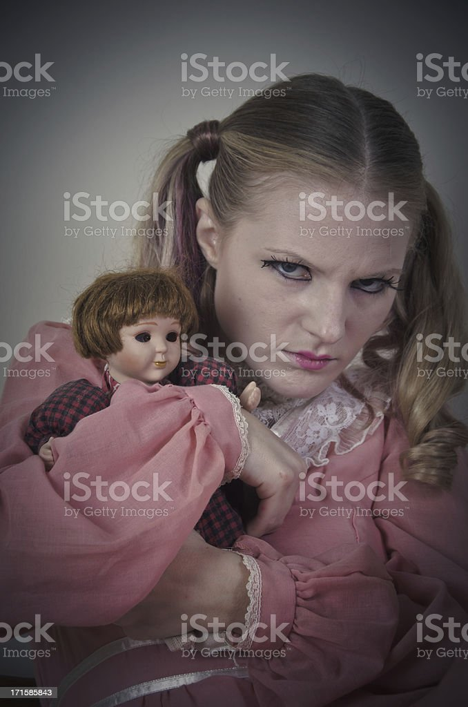 Crazy Little Girl Holding Doll royalty-free stock photo