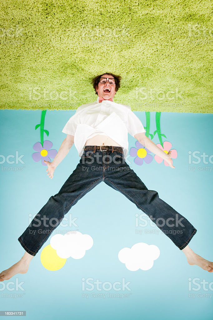 Crazy Man Grows Out of Ground in Upside Down World royalty-free stock photo
