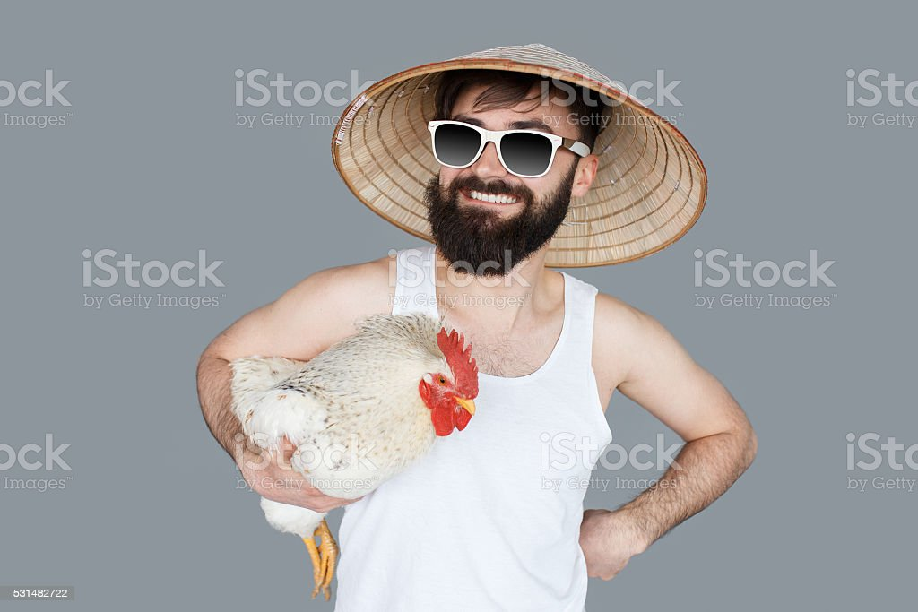 Crazy man holding a cock going to vacation stock photo