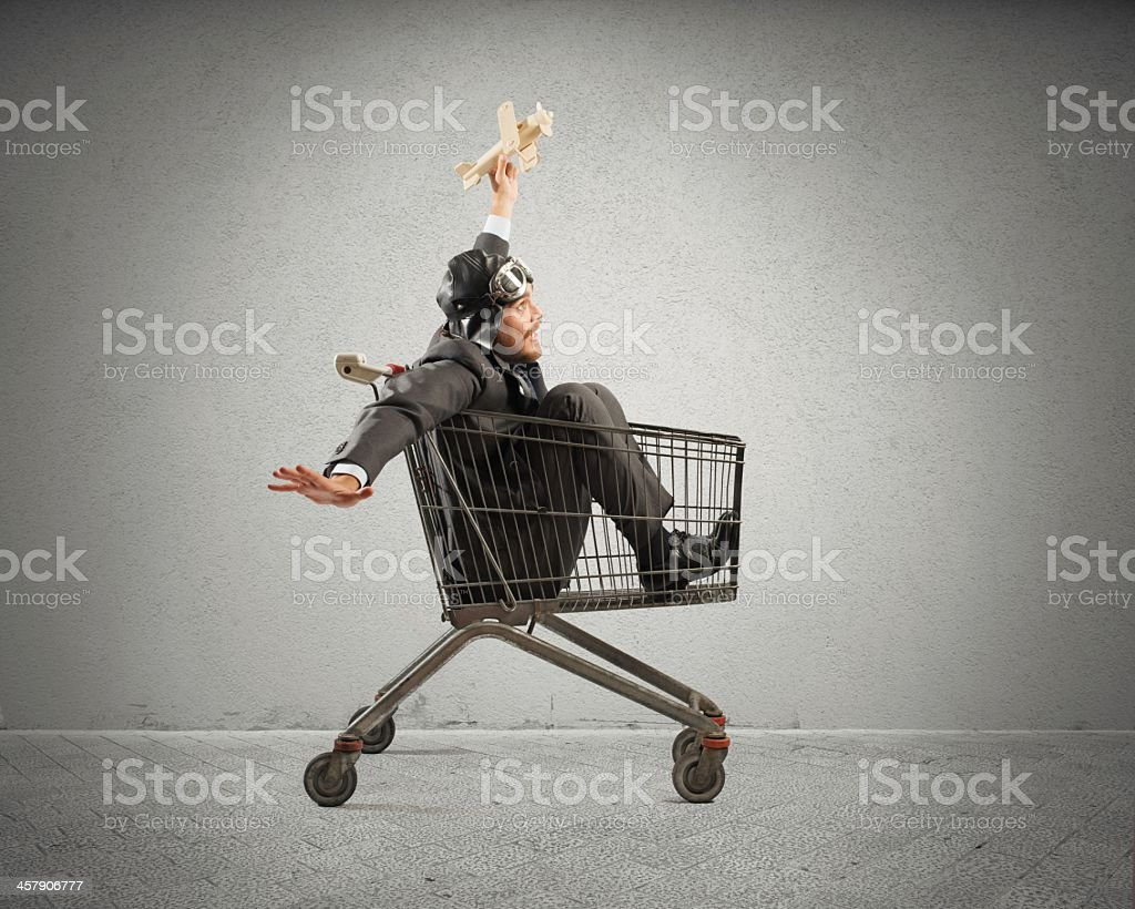 A crazy man in a trolley like a child  stock photo