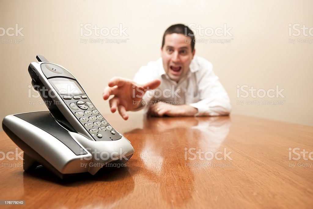 Crazy man reaching for the phone royalty-free stock photo