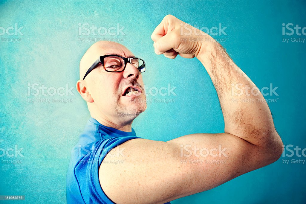 crazy man showing  proudly  its muscles stock photo