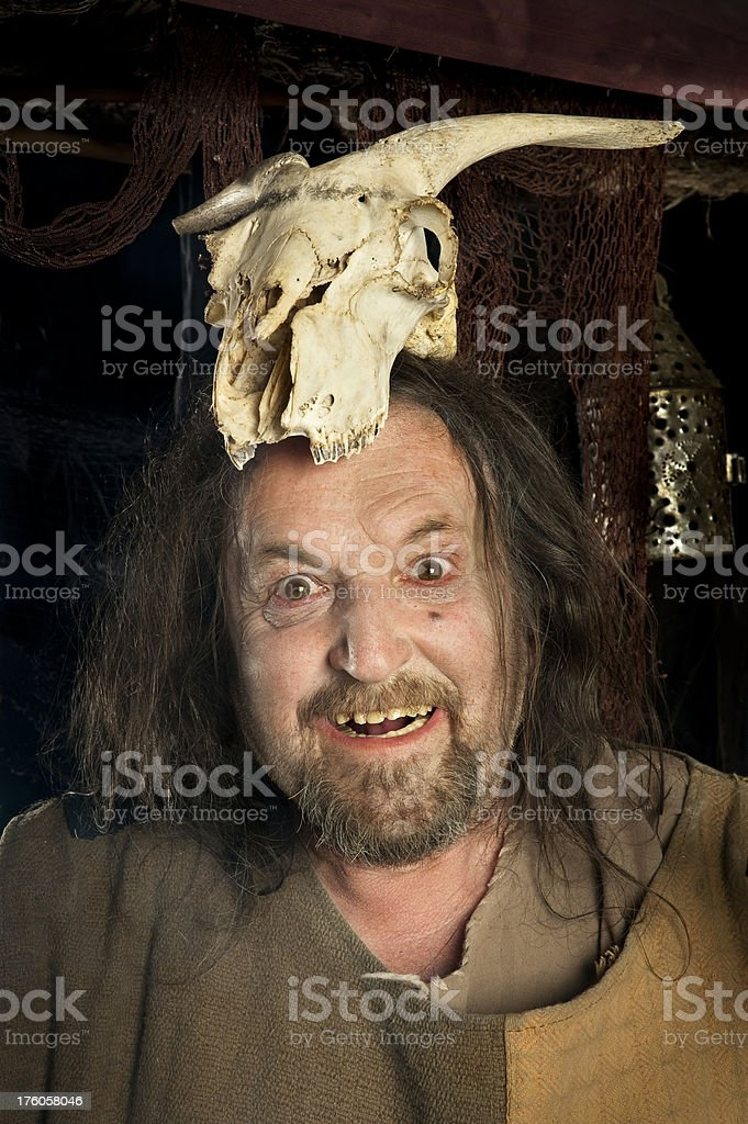 Crazy man with a skull royalty-free stock photo