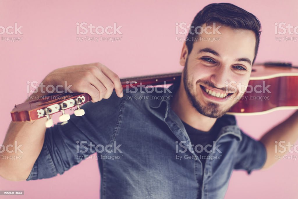 Crazy man with guitar... stock photo