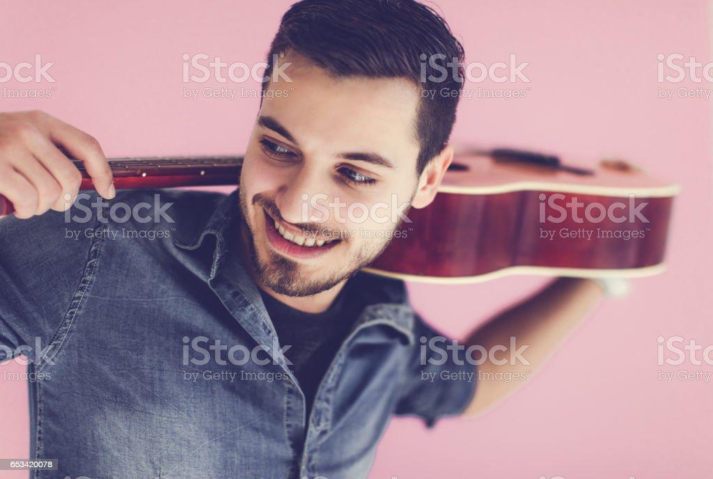 Crazy man with guitar... stock photo