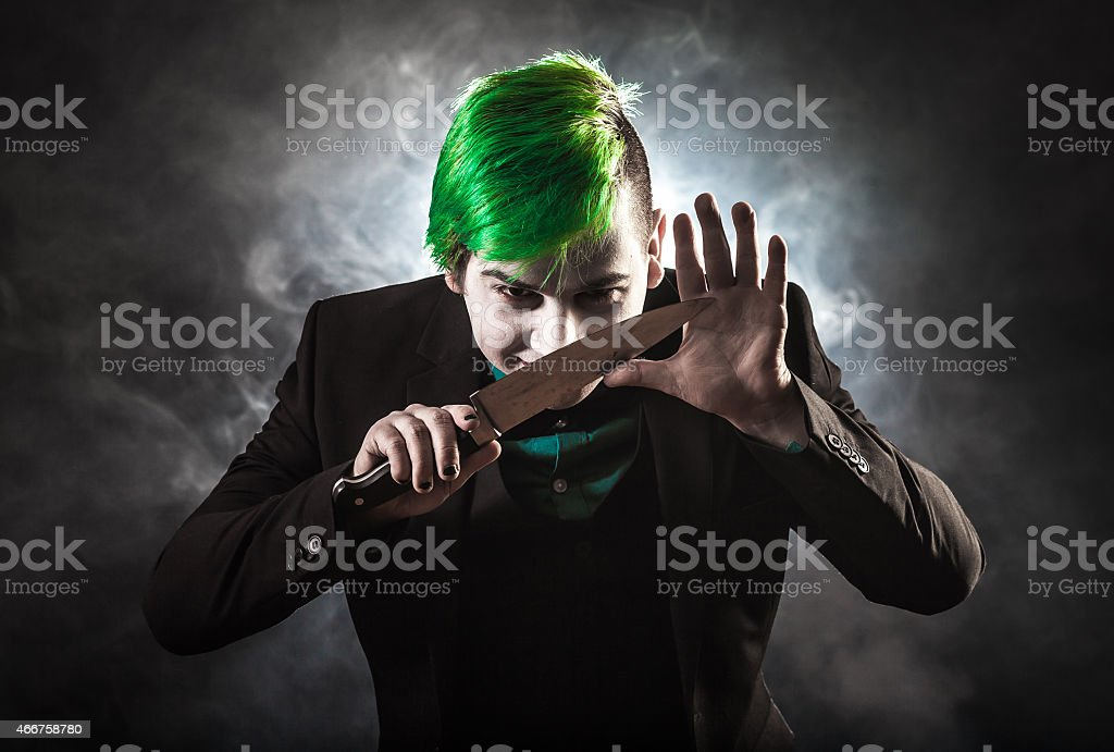 Crazy man with knife stock photo