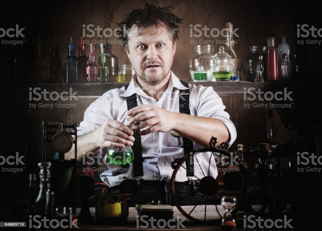 crazy medieval scientist working in his laboratory stock photo