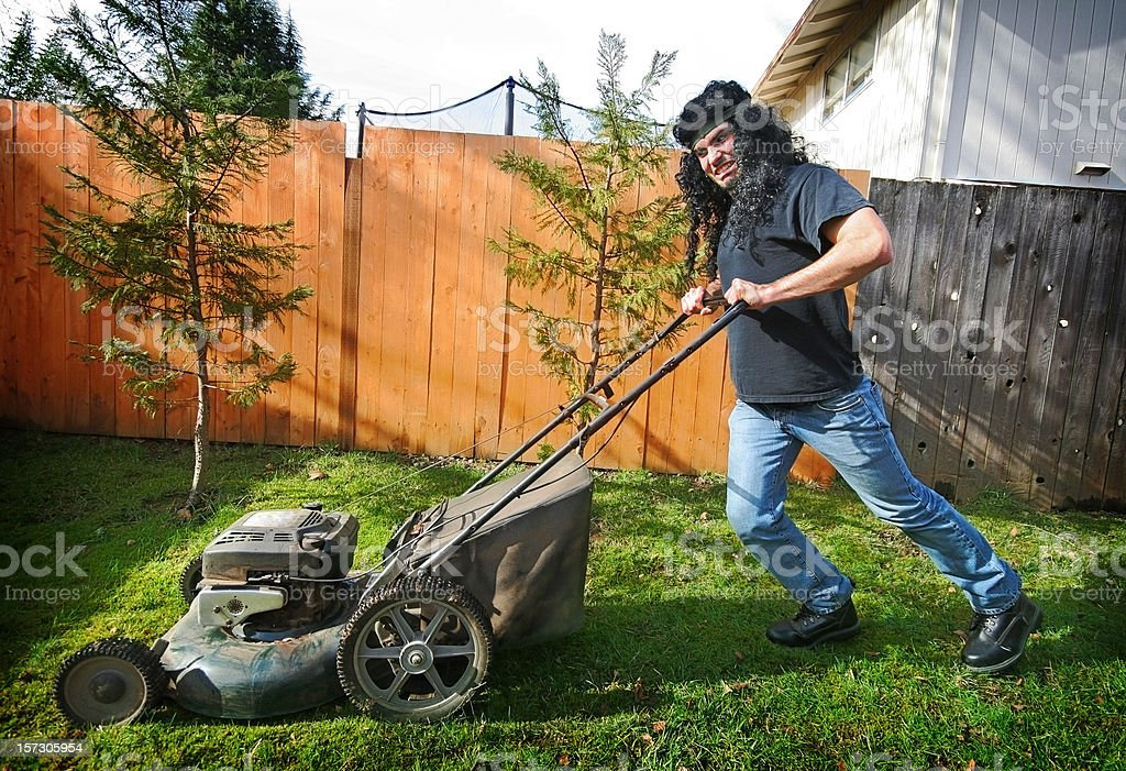 Crazy Rock and Roll Lawn Mower Man stock photo