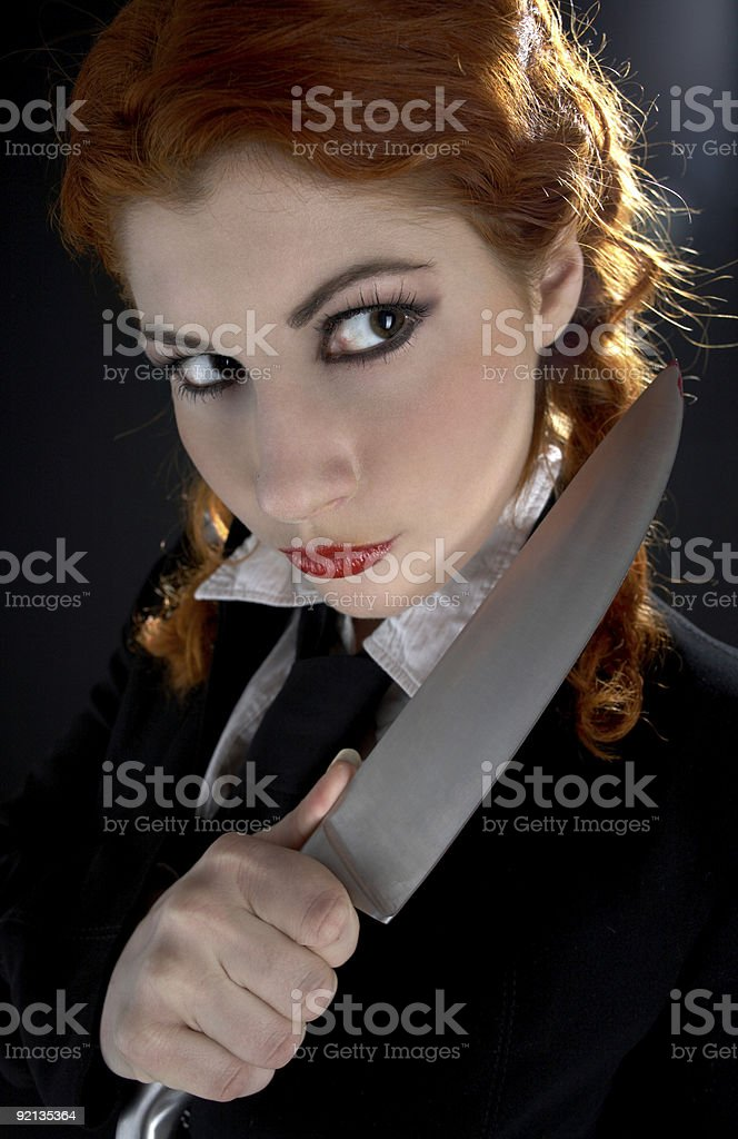 crazy schoolgirl with knife royalty-free stock photo