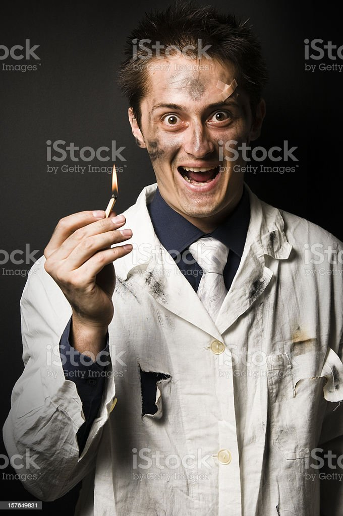 Crazy scientist with match on fire in his hand royalty-free stock photo