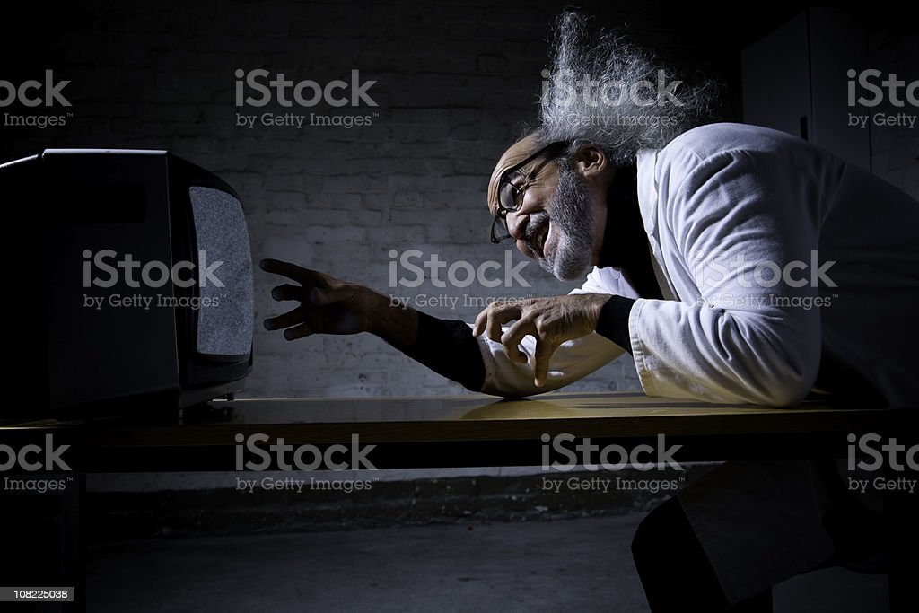 Crazy Scientist with Wild Hair Looking at Television royalty-free stock photo