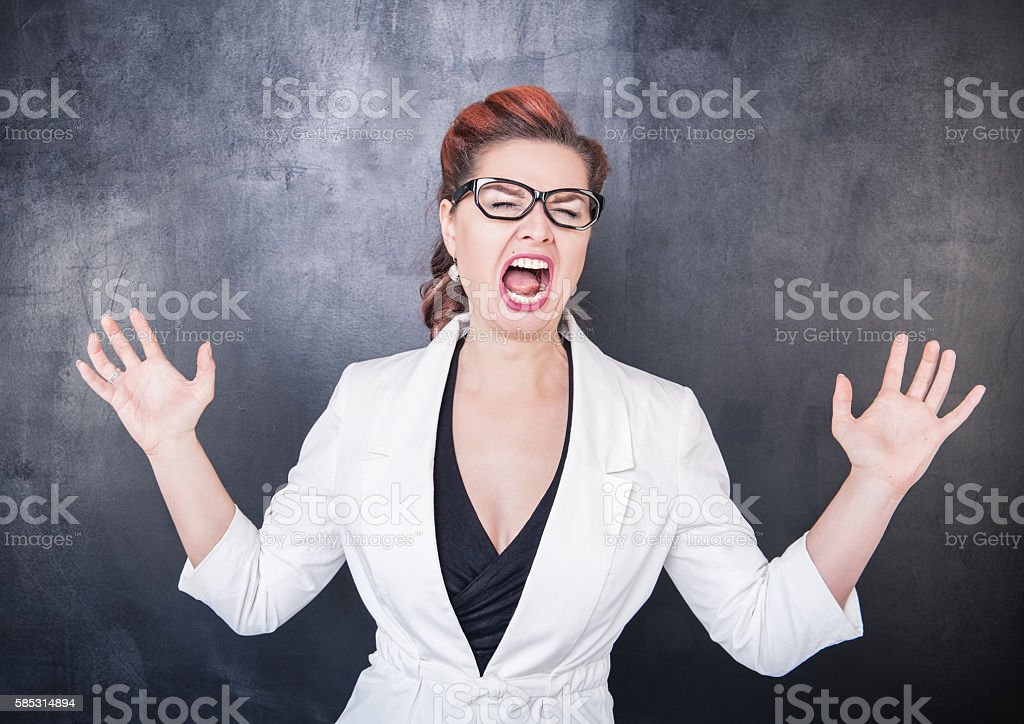 Crazy screaming teacher stock photo