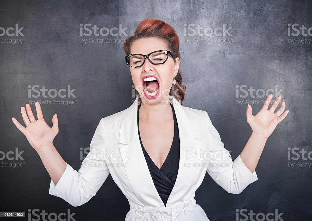 Crazy screaming woman stock photo